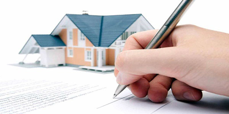 signing the deal to buy a home