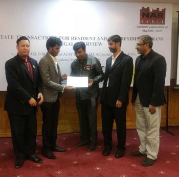 recieving awards from Mr Preetam D'Souza Mt Ajay G Prasad , acompanied By Mr NRB Garda and Mr NA Afzal