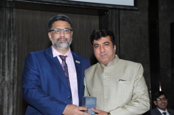 Token of appreciation By Mr Ayub Khan - Hon Gen Secretary Bangalore Realtors Association India